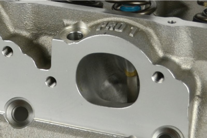 Exhaust ports on many performance aftermarket heads are raised in order to improve exhaust port flow. While the flange pattern is the same, it can be raised by as much as 0.500-inch which can affect fitment with an off-the-shelf chassis header.